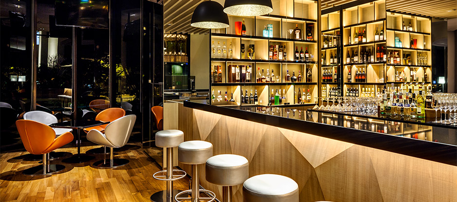 Unwind over bespoke cocktails and live music at Atrium Bar 317 in the evenings