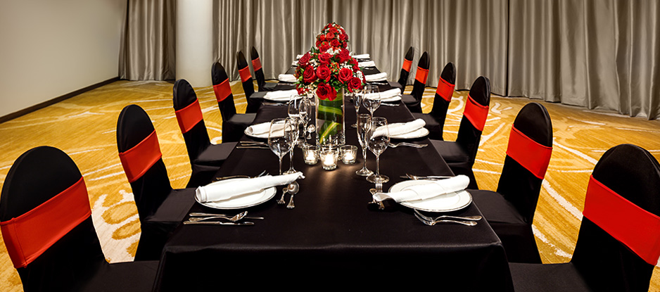 Red and Black Themed Dining Table with Red Roses in Centre