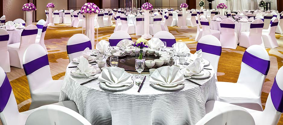 View of Atrium Ball Room with White and Purple Seating Setting