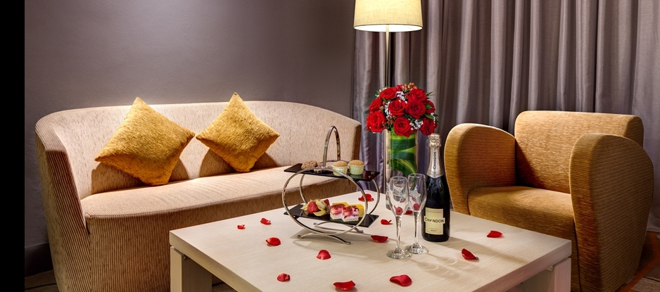 Romantic Seating area with Red Roses and Champagne on the Table